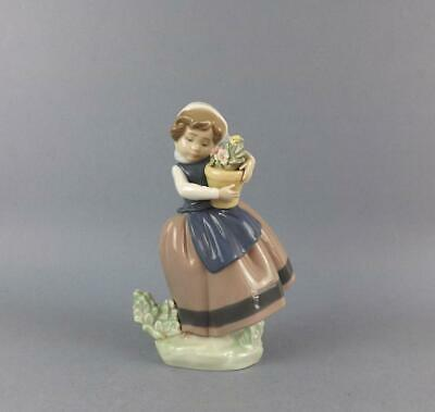 An Exquisite Porcelain Spanish Lladro Figurine of a Girl with Flowers.