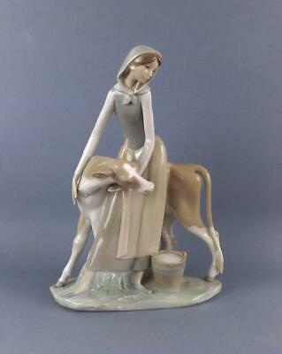 A Beautiful Large Lladro Porcelain Figurine of Young Girl with Cow.