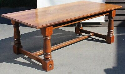 Good 1920's Oak Refectory Table Solid and sturdy. Cross Stretcher. Rose Carving