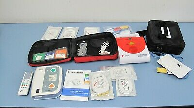 Lot Of Two Practi-Trainer & American Red Cross, AED Trainers With Pads & Access.