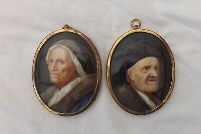 A PAIR OF ANTIQUE MINATURE PAINTINGS ON CERAMIC TILES SET IN LOCKET FRAMES 1880s