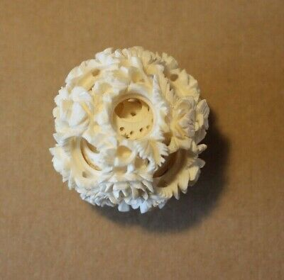 Antique 19th Century Chinese Carved Puzzle Ball with Floral Design.