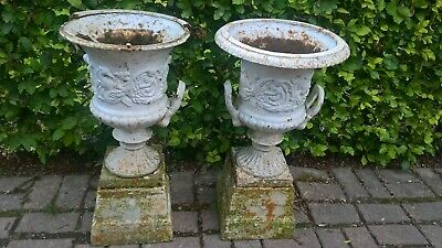 Pair of matching Victorian Cast Iron Garden Urns 70cm tall Cherub & Bird design