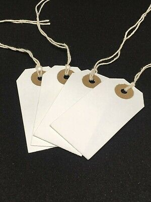 100 WHITE STRUNG PRICE TAG// TAGS// SWING TICKETS// TIE ON LABELS Size: 54 x 35mm