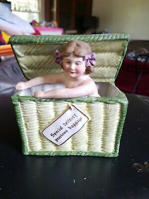 ANTIQUE GERMAN Germany GIRL DOLL in basket PIANO BABY BISQUE FIGURINE