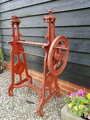 Vintage Cast Iron Mangle with cast iron legs garden feature CT logo