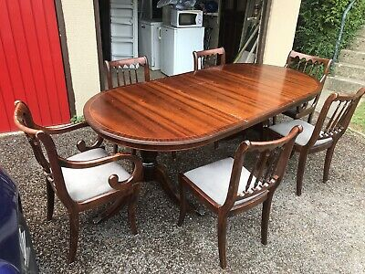Extending mahogany dining table And 6 Chairs. Needs A Small Bit Of Repair