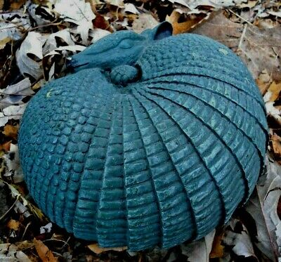 Latex armadillo mold with plastic backup plaster and concrete mould