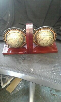 a good pair of wooden bookends with globe decoration