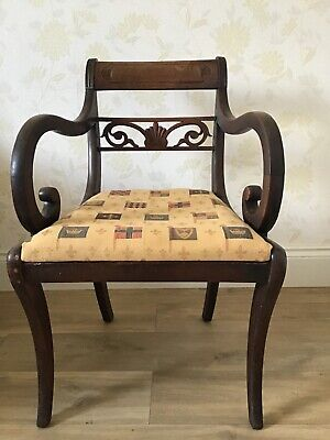 An Antique Victorian (?) wooden carver chair with upholstered padded seat