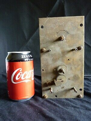 Large antique brass clock movement with serial number