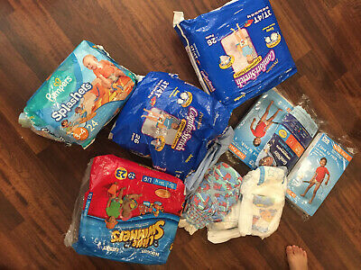Lot of 3-4 Training and Swimming Diapers More Than 50 diapers! Huggies Pampers O