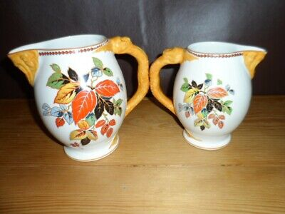 Lovely Pair of Losol Ware Jugs with serpent handles