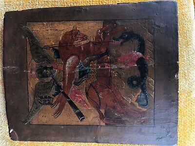 Antique Russian Icon depicting Archangel Michael fighting a dragon.