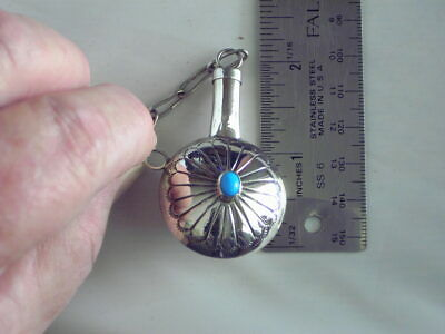 Sterling silver Nativie American Perfume bottle with engraving and turquoise .
