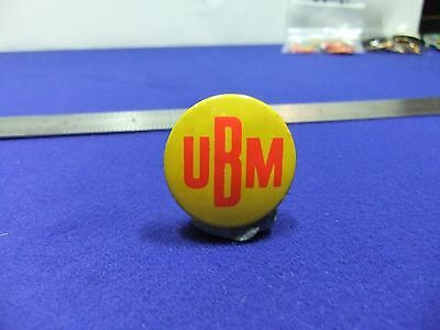 vtg badge ubm tin badge 1960s 70s  ? music media pop ?
