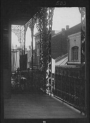 Upper level balcony,wrought iron,St Peter Street,New Orleans,LA,A Genthe,1 7593