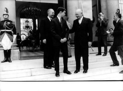 """American politician Dwight David """"Ike"""" Eisenhower holding a man and smiling. - O"""
