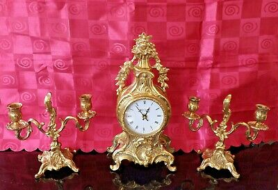 Modern Quartz Clock In The French Rococo Style With Candlestick Garnitures.