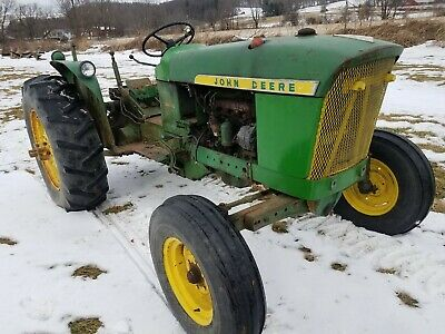 John Deere 2010 tractor hood w/ emblems sold as is