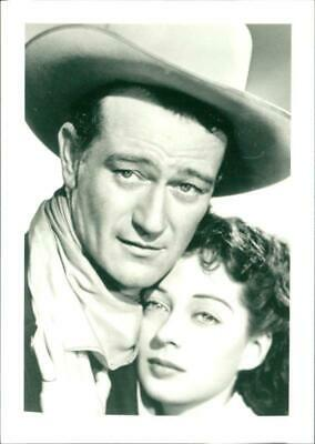 Photograph of John Wayne with Gail Russell in film 'Angel and the Badman'