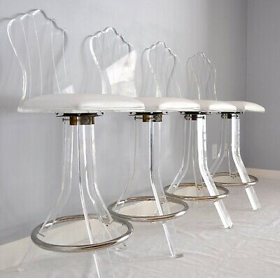 LUCITE BAR STOOLS SET OF 4  Clear lucite with Chrome footrest