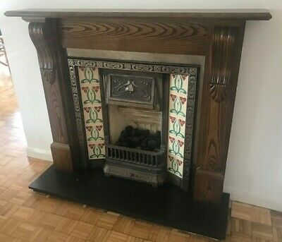 Art Nouveau cast iron fireplace with tiled sides