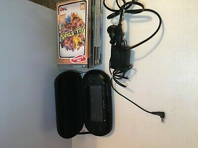 PSP E1000 black with charger, case and games!