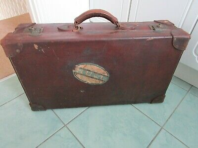 Vintage retro large brown leather suitcase with travel labels, linen interior,