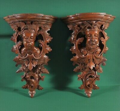 Antique pair of richly carved wooden wall console, 19th century