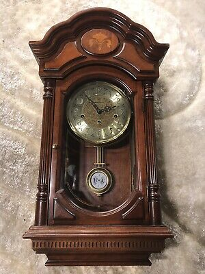 613-302 Howard Miller Triple Chiming Inlayed Cherry Case,Keywound Wall Clock