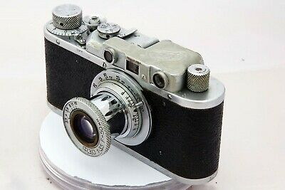 Fed 1 35mm camera w. f:3.5/50mm lens. Wooden custom-made case. See below. ERC.