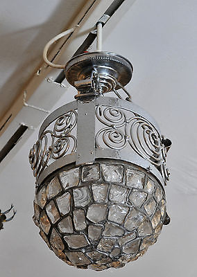 Art deco chandelier decorated with glass cullets,