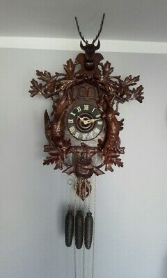 Old Black Forest cuckoo clock with quail
