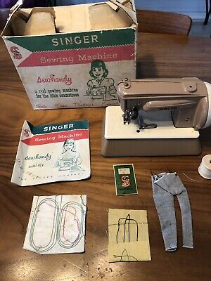Vintage Childrens Singer sewing machine in original packaging