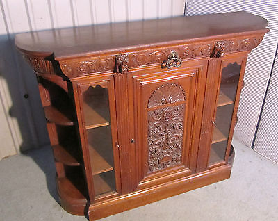 A Gothic Arts and Crafts Carved Golden Oak  Sideboard by Gillows 1870