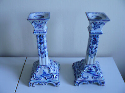 A near pair of 19th Century Delft blue and white candlesticks