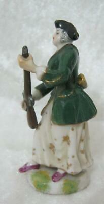 Miniature late 19th Century Porcelain figure of Tiny woman figure with gun
