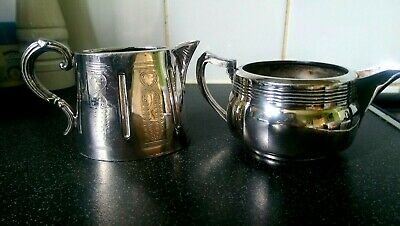 Two Silver Plated Cream Or Milk Jugs