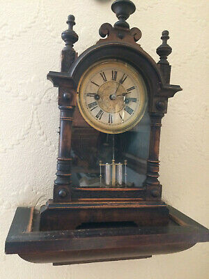 antique black forrest bracket clock.with bracket