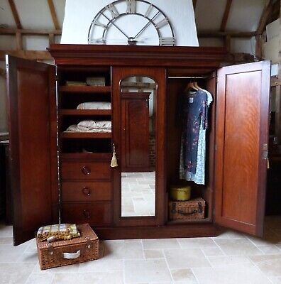 Large Victorian mahogany triple mirror door linen press wardrobe by T. Willson