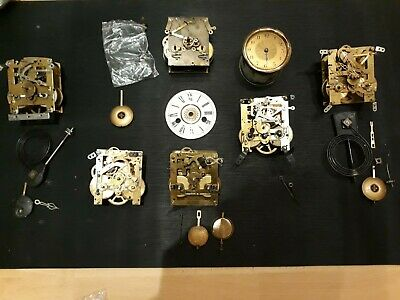 Various Old Clock movements, Hands,Pendulums Enamel face ect