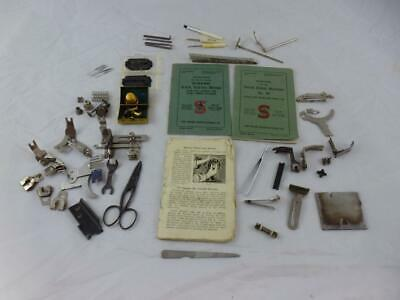 Vintage Sewing Machine Attachments & Singer Sewing machine instruction books.