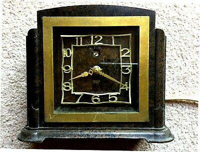Smith's Sentric bakelite electric clock with quirky  face. Spares or Repair.