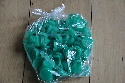 100 green plastic milk bottle tops