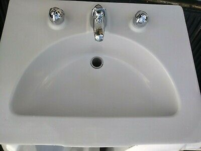 Vintage porcelain Crane Diana sink with faucet and plumbing.