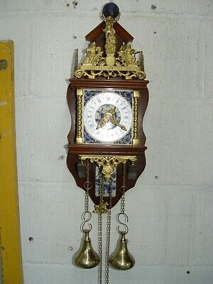 Dutch wall clock with delft tile decorations