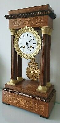 A Charles X rosewood inlaid and gild metal mounted portico clock