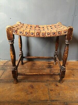 Antique leather strapped & riveted wooden stool