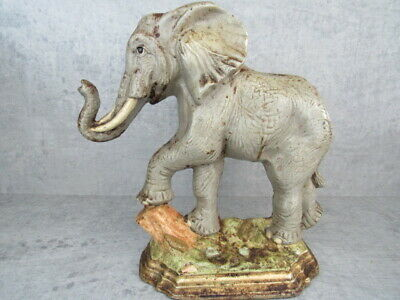 Antique Large Elephant Cast Iron Doorstop  Trunk Up Foot On Tree Trunk